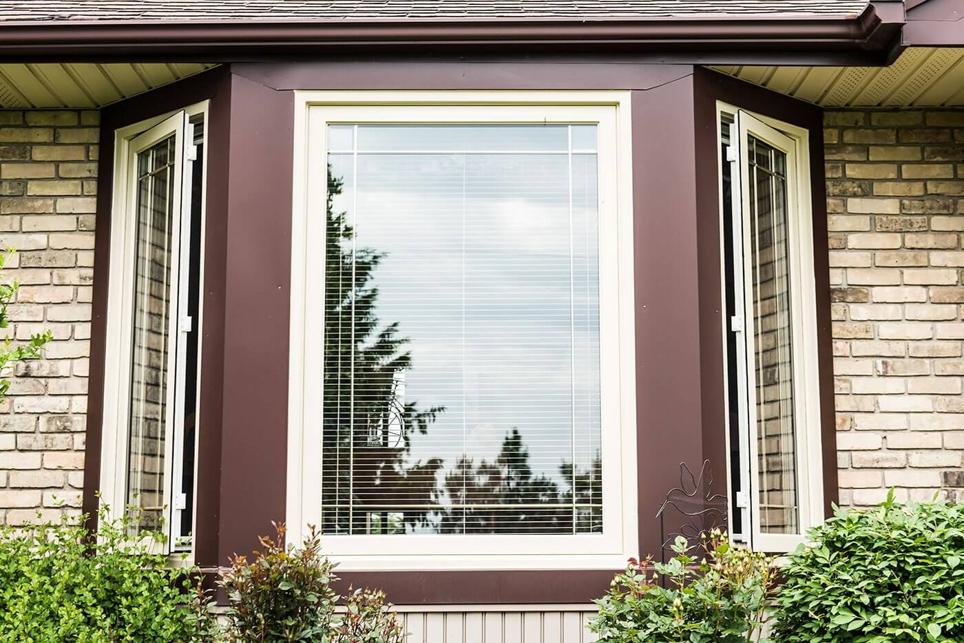 Close Up of Large Custom Made Bay Window With Thick Brown Trim Design