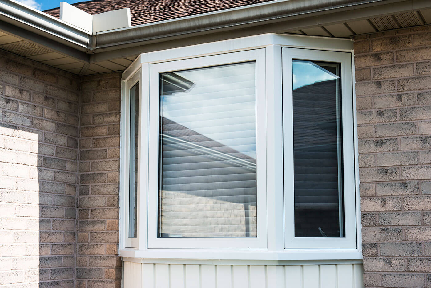 Custom Manufactured Bay Window With White Trim Design