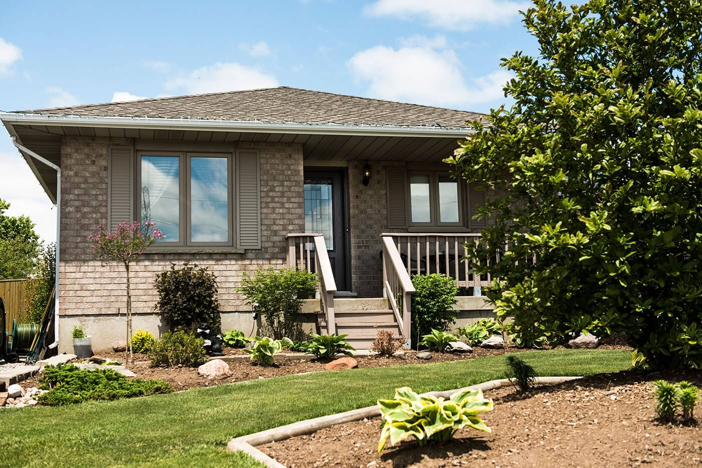 Front of a Small Bungalow Home Showcasing Multiple New Casements Windows