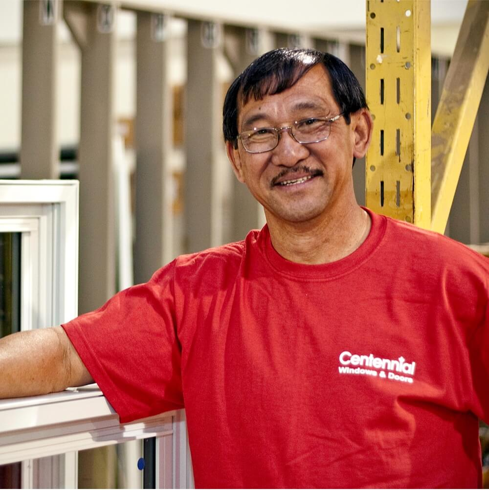 Centennial Windows and Doors Employee Smiling Inside Manufacturing Facility