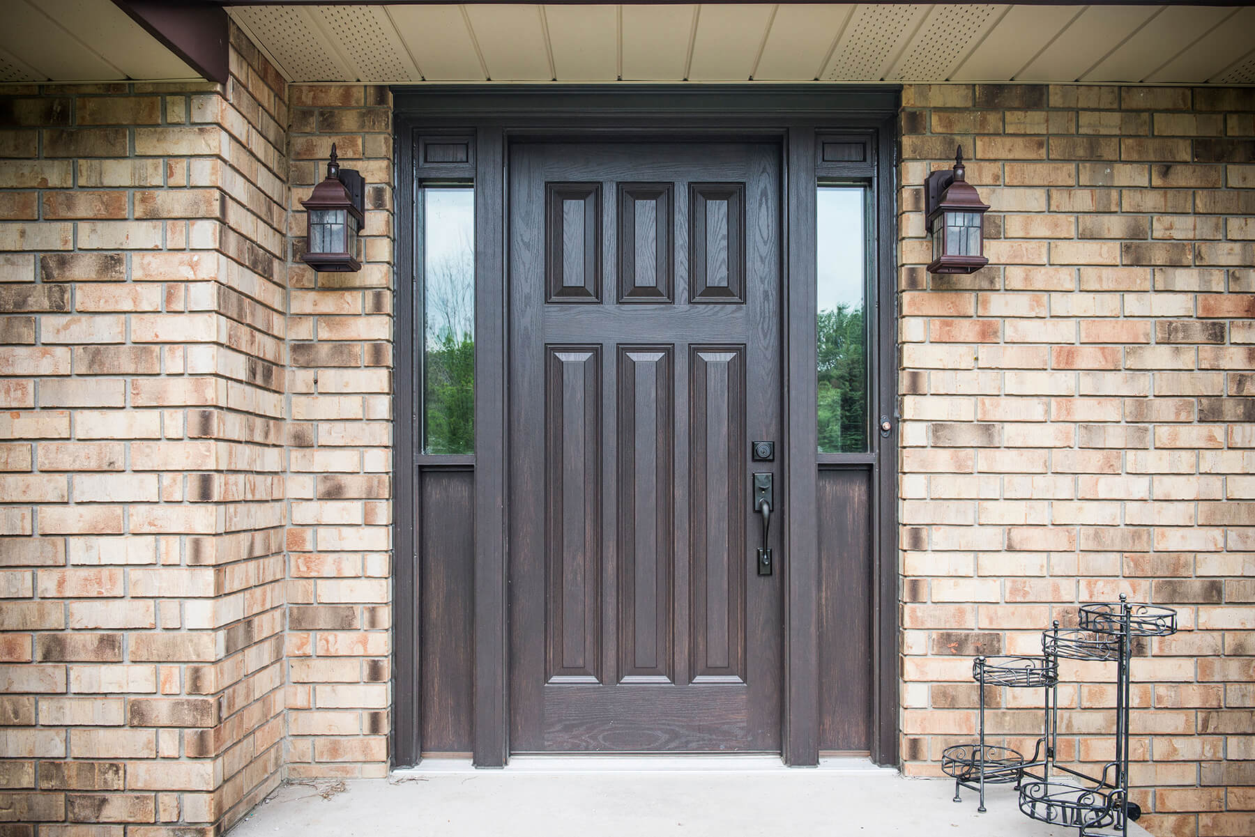 Older Style Country Home With Custom Made Door Entry System Painted Black