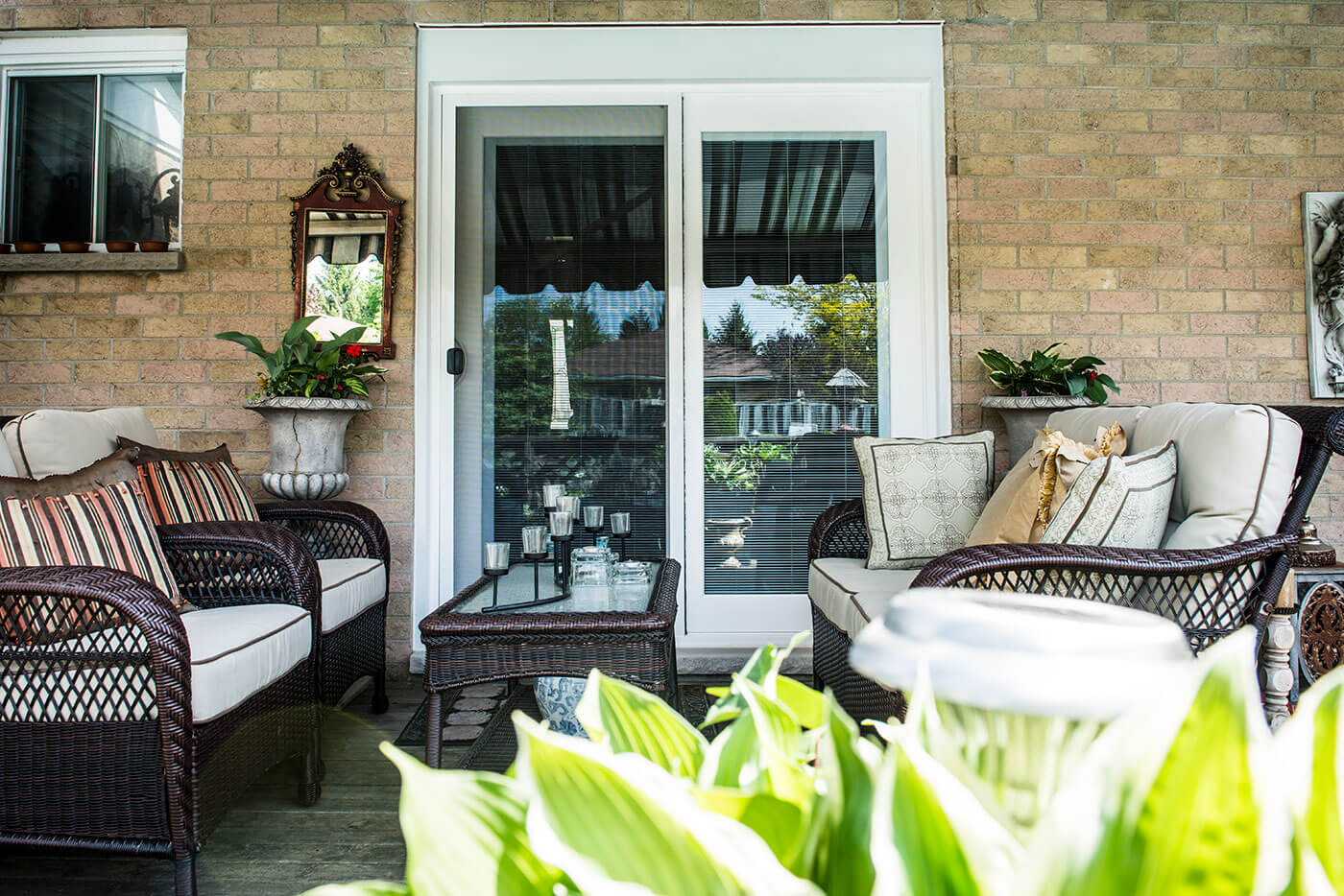 Backyard Patio of Gorgeous Home Showcasing New Sliding Glass Patio Doors