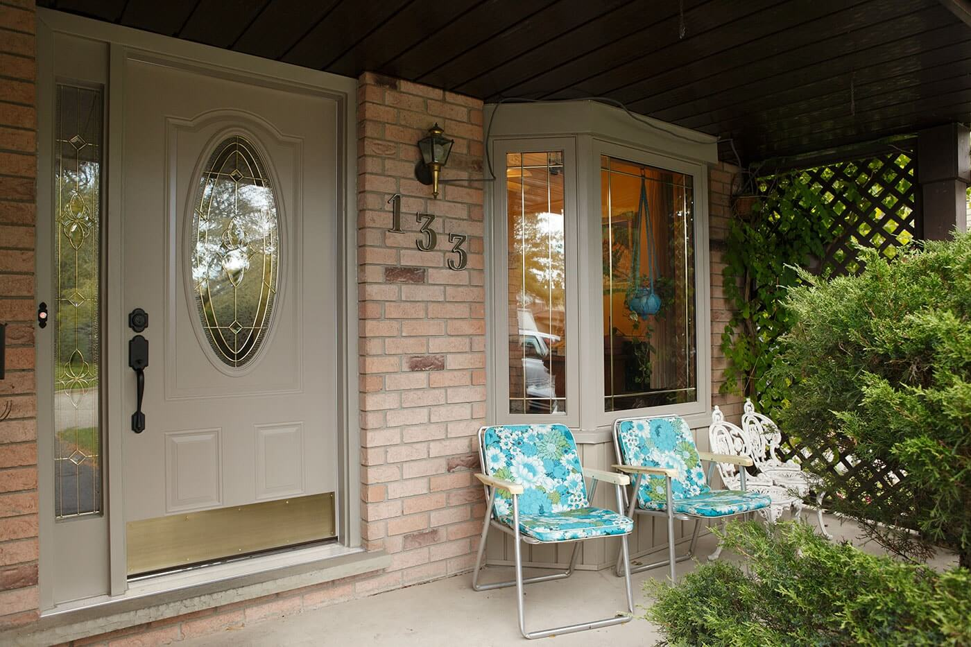 Front Porch of Home With Custom Steel Entry Door System and Large Bay Window