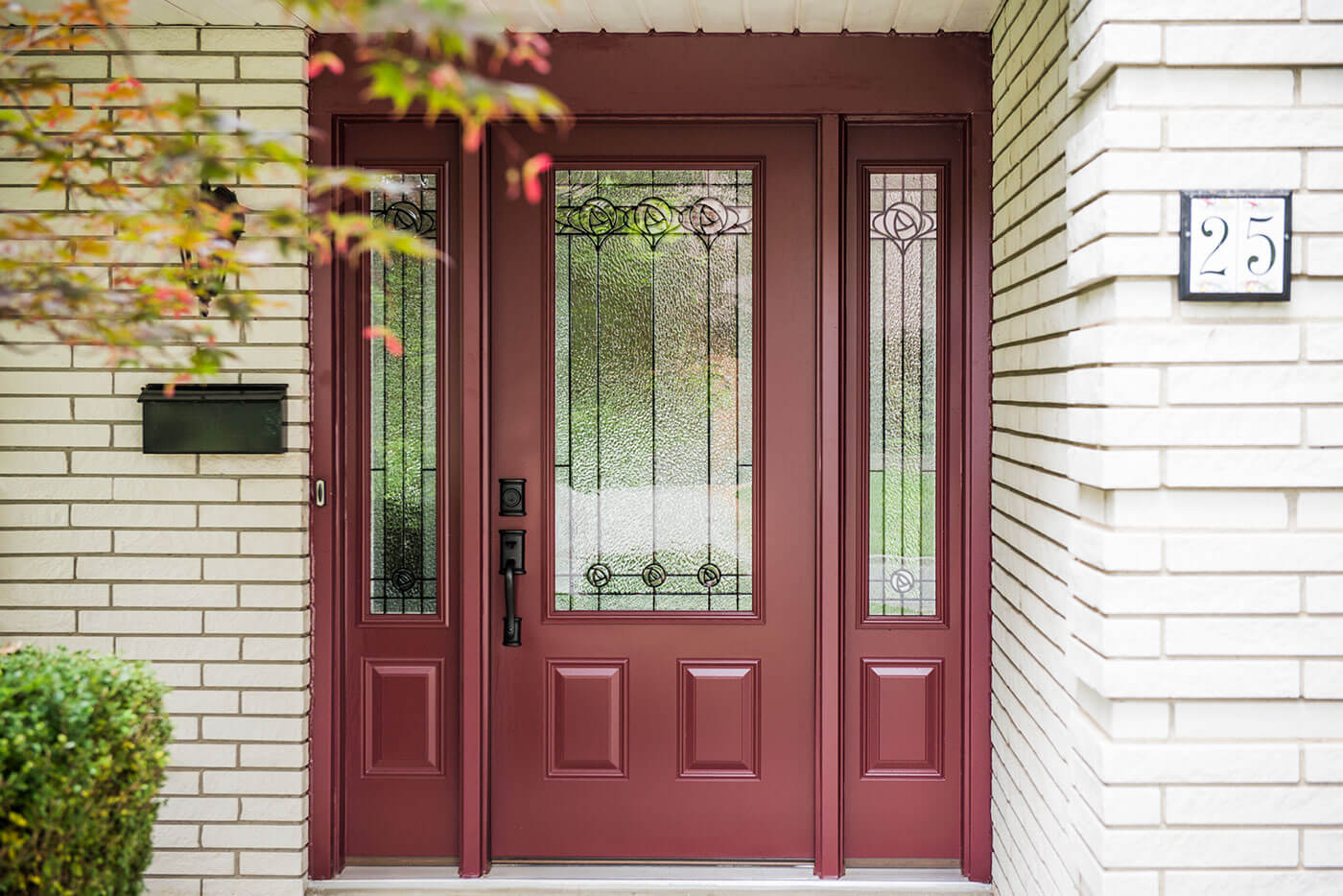 Steel Entry Door System Custom Manufactured in a Dark Red Colour With a Glass Window